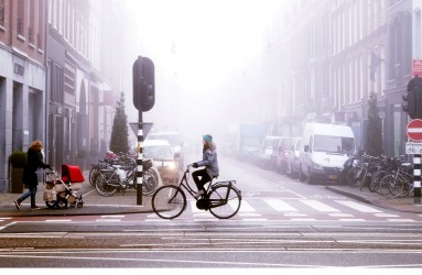 Biking in foggy Amsterdam